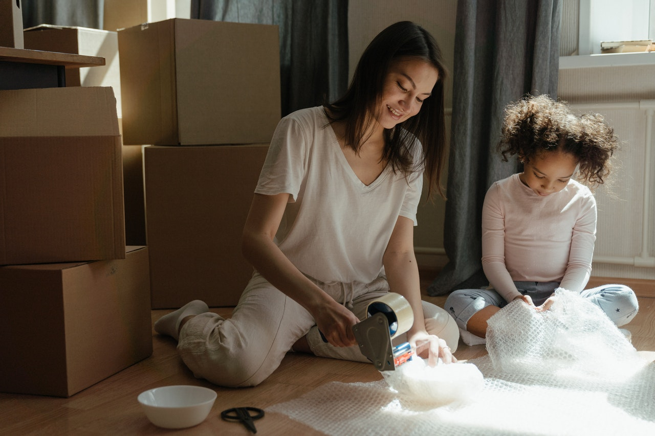 A mother and her daughter prepping belongings for storage.