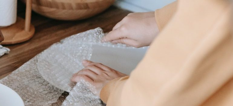 person packing a plate