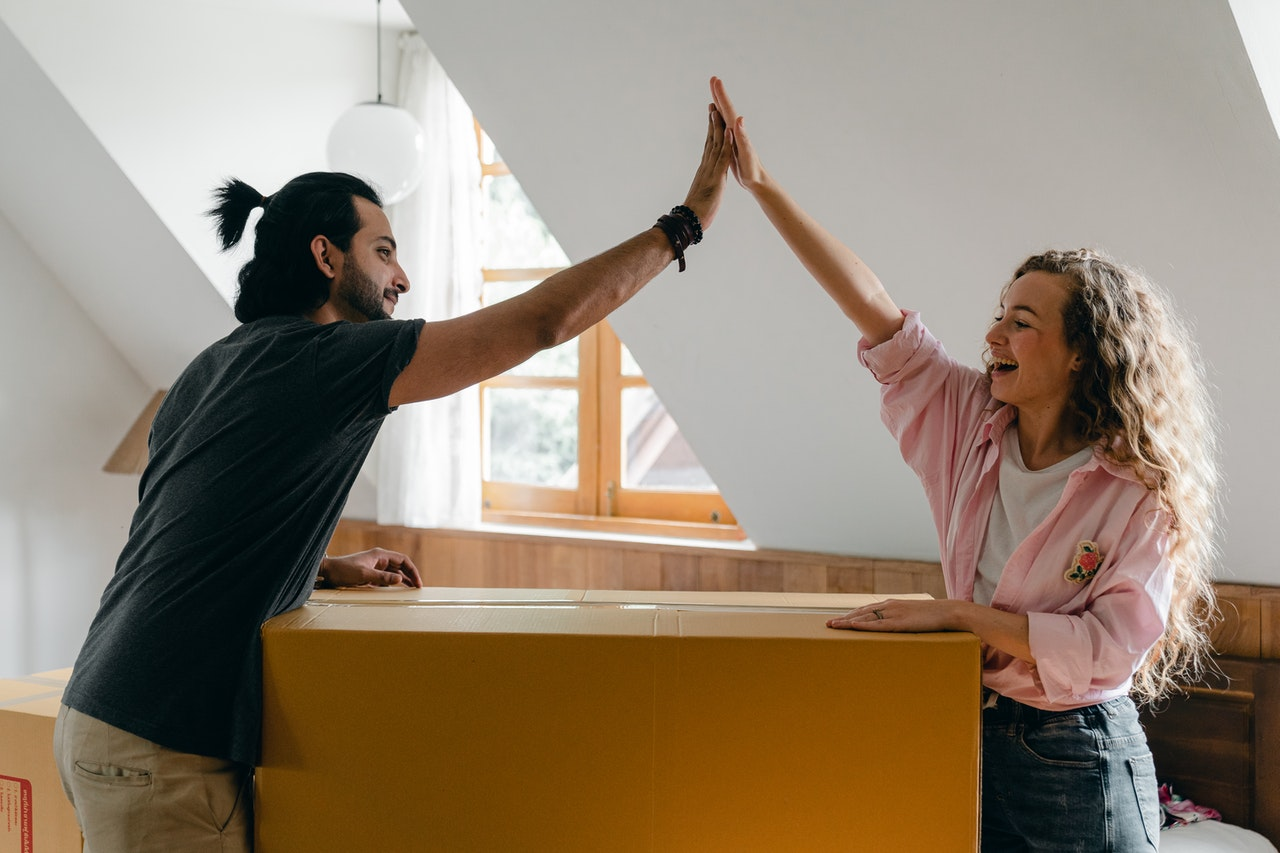 A couple high-fiving after beating all the challenges of moving locally.