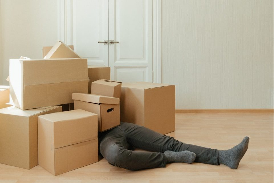 man cramped by boxes