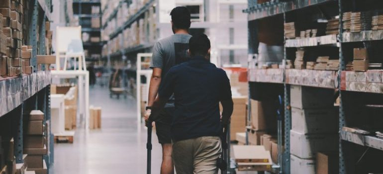 people walking in a storage facility
