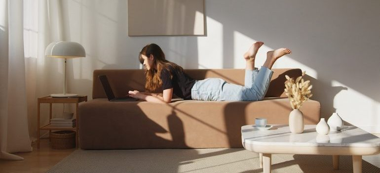 A young woman looking for reliable storage companies and tips on how to store your wooden furniture safely.
