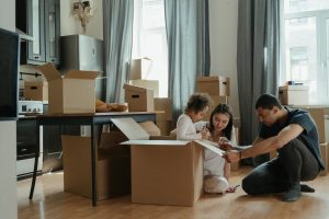Family packing for a move after deciding to relocate to one of the best