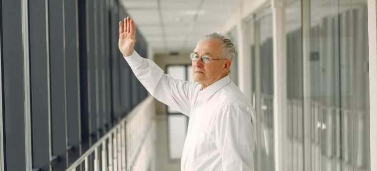 a person waving at a window