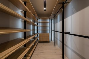 an empty storage with wooden shelves