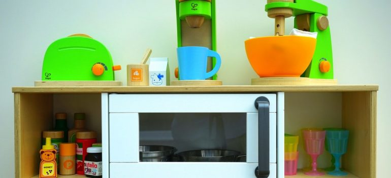 a toy kitchen with various appliances