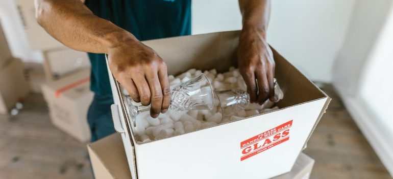 financial district movers packing glasses