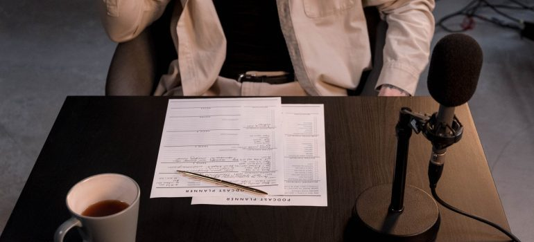 A person with documents on a table
