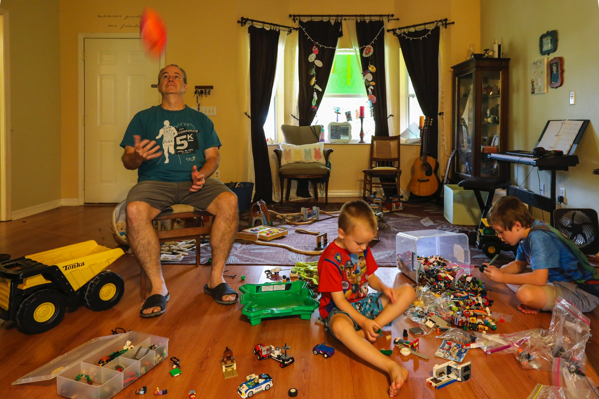 playing with kids and thinking how to free up your living area