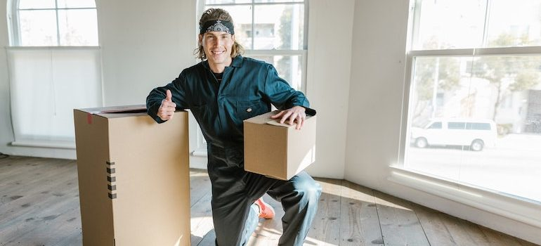 man holding a box and smiling