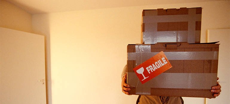 a man carrying boxes