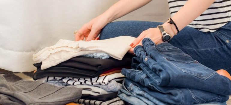 A woman sorting out clothes