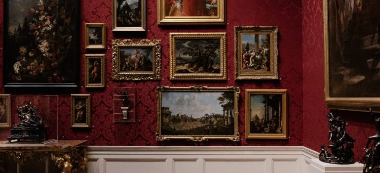 Paintings hanged on a red wall