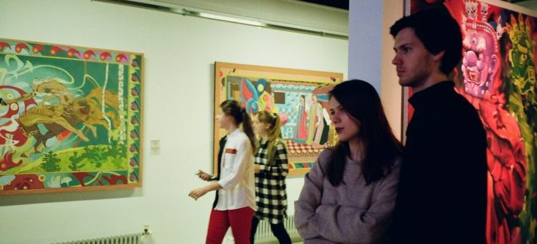 A couple visiting art gallery