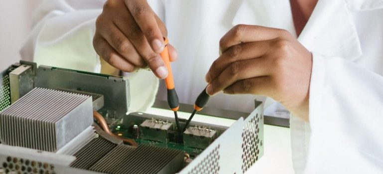 person repairing an electronic part